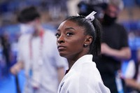 Simone Biles, of the United States, waits for her turn to perform during the artistic gymnastics women's final at the Summer Olympics, on July 27, 2021, in Tokyo. (AP Photo/Gregory Bull)