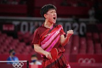 Japan's Tomokazu Harimoto gestures during the table tennis men's singles round of 16 match against Slovenia's Jorgic Darko at the Summer Olympics, on July 27, 2021, in Tokyo. (AP Photo/Kin Cheung)
