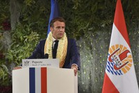 France's President Emmanuel Macron wearing a flower lei and seashell necklaces delivers a speech after a meeting with the President of the French Polynesia Edouard Fitch in Tahiti, French Polynesia in the Pacific Ocean, on July 27, 2021. (AP Photo/Esther Cuneo)