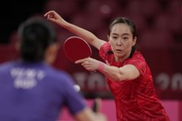 Japan's Kasumi Ishikawa competes during the table tennis women's singles quarterfinal match against Singapore's Yu Mengyu at the 2020 Summer Olympics, on July 28, 2021, in Tokyo. (AP Photo/Kin Cheung)