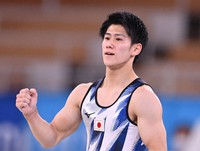 Japan's Daiki Hashimoto pumps his fist after performing his floor exercise in the men's individual all-around final in the Tokyo Olympics, at Ariake Gymnastics Centre, Tokyo, on July 28, 2021. (Mainichi/Toshiki Miyama)