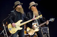 Dusty Hill, left, and Billy Gibbons from U.S rock band ZZ Top perform at the Glastonbury music festival in Somerset, England, June 24, 2016. (Photo by Jonathan Short/Invision/AP)