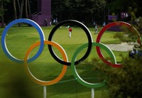 Austria's Sepp Straka, center, makes a putt on the 16th hole during the first round of the men's golf event at the Summer Olympics on July 28, 2021, at the Kasumigaseki Country Club in Kawagoe, Japan. (AP Photo/Matt York)