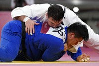 Aaron Wolf of Japan, top, and Cho Gu-ham of South Korea compete in the men's -100kg final judo match of the 2020 Summer Olympics in Tokyo, on July 29, 2021. (AP Photo/Vincent Thian)