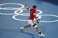 Kei Nishikori, of Japan, plays Novak Djokovic, of Serbia, during the quarterfinals of the tennis competition at the 2020 Summer Olympics, on July 29, 2021, in Tokyo, Japan. (AP Photo/Seth Wenig)