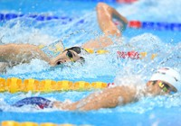 Athletes swim in the men's 400-meter individual medley qualifier at Tokyo Aquatics Centre on July 24, 2021. (Mainichi/Toshiki Miyama)