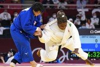Akira Sone of Japan, left, and Idalys Ortiz of Cuba compete during their women's +78kg gold medal judo match at the 2020 Summer Olympics, Friday, July 30, 2021, in Tokyo. (AP Photo/Vincent Thian)