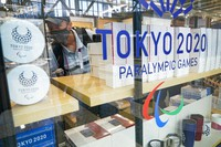 A man shops inside a store at the Main Press Center at the 2020 Summer Olympics, on July 21, 2021, in Tokyo. (AP Photo/Ashley Landis)