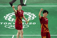 Japan's Yuta Watanabe, right, and Arisa Higashino celebrate after winning their mixed doubles badminton bronze medal match against Hong Kong's Tang Chun Man and Tse Ying Suet at the Summer Olympics, on July 30, 2021, in Tokyo, Japan. (AP Photo/Markus Schreiber)