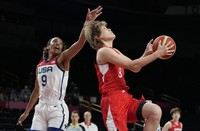 Japan's Maki Takada (8), right, drives past United States' A'Ja Wilson (9) during women's basketball preliminary round game at the 2020 Summer Olympics, on July 30, 2021, in Saitama, Japan. (AP Photo/Eric Gay)