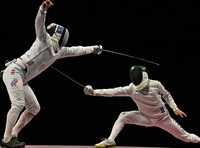 Japan's Masaru Yamada, right, wins a point in the men's epee team gold medal match at the Tokyo Summer Olympics, on July 30, 2021, at Makuhari Messe Hall B in Chiba Prefecture. (Mainichi/Toshiki Miyama)