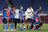 Japan's players react after losing 1-3 against Sweden at the end of a women's quarterfinal soccer match at the 2020 Summer Olympics, on July 30, 2021, in Saitama, Japan. (AP Photo/Martin Mejia)