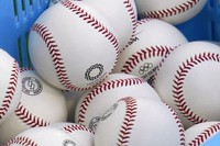 A basket of baseball is pictured before a baseball game between Israel and the United States at the 2020 Summer Olympics, on July 30, 2021, in Yokohama, Japan. (AP Photo/Sue Ogrocki)
