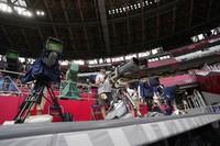 Cameramen work at the 2020 Summer Olympics, on July 31, 2021, in Tokyo. (AP Photo/Petr David Josek)
