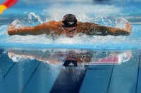 Caeleb Dressel, of the United States, swims in the men's 100-meter butterfly final at the Summer Olympics, on July 31, 2021, in Tokyo, Japan. (AP Photo/Gregory Bull)