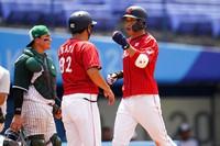 Japan's Tetsuto Yamada, right, celebrates after hitting a three-run home run during a baseball game against Mexico at Yokohama Baseball Stadium during the Summer Olympics, on July 31, 2021, in Yokohama, Japan. (AP Photo/Matt Slocum)