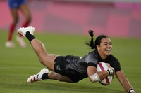 New Zealand's Stacey Fluhler dives to score a try, in the women's rugby gold medal match between New Zealand and France at the 2020 Summer Olympics, on July 31, 2021 in Tokyo, Japan. (AP Photo/Shuji Kajiyama)