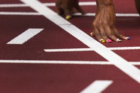 Javianne Oliver, of United States, prepares to start in her heat of the women's 100-meters at the 2020 Summer Olympics, Friday, July 30, 2021, in Tokyo. (AP Photo/Matthias Schrader)