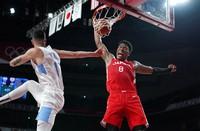Japan's Rui Hachimura (8) dunks over Argentina's Luca Vildoza (17) during men's basketball preliminary round game at the 2020 Summer Olympics, Sunday, Aug. 1, 2021, in Saitama, Japan. (AP Photo/Charlie Neibergall)