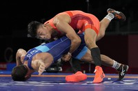 Japan's Kenichiro Fumita, right, competes against Ukraine's Lenur Temirov during the semi-final round of the men's 60kg Greco-Roman wrestling match at the 2020 Summer Olympics, Aug. 1, 2021, in Chiba, Japan. (AP Photo/Aaron Favila)