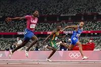 Lamont Jacobs, right, of Italy, wins the men's the 100-meter final at the 2020 Summer Olympics, Aug.1, 2021, in Tokyo.(AP Photo/David J. Phillip)