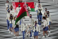 Athletes from Belarus walk during the opening ceremony in the Olympic Stadium at the 2020 Summer Olympics, July 23, 2021, in Tokyo, Japan. (AP Photo/David J. Phillip)