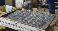 Glass globes are cooled in the workshop at Shinohara Furin Honpo in Tokyo's Edogawa Ward on July 8, 2021. (Mainichi/Akinori Miyamoto)