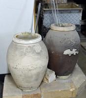 Crucibles placed inside the furnace for creating hand-blown glass are seen at Shinohara Furin Honpo in Tokyo's Edogawa Ward on July 8, 2021. (Mainichi/Akinori Miyamoto)