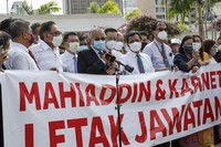 Malaysian opposition members Anwar Ibrahim, third from left, and Mahathir Mohamad, fifth from left, speak to the media during a protest in Kuala Lumpur, Malaysia, on Aug. 2, 2021. (AP Photo/FL Wong)