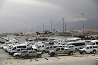In this July 5, 2021 file photo, vehicles are seen parked at Bagram Airfield after the American military left the base, in Parwan province north of Kabul, Afghanistan. (AP Photo/Rahmat Gul)
