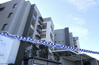 Police tape is seen at a lock downed apartment building at Devitt Street in the south western suburb of Blacktown in Sydney, on July 28, 2021. (Mick Tsikas/AAP Image via AP)