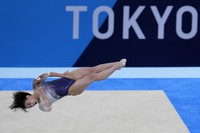 Mai Murakami, of Japan, performs on the floor during the artistic gymnastics women's apparatus final at the 2020 Summer Olympics, on Aug. 2, 2021, in Tokyo. (AP Photo/Gregory Bull)