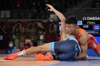 Japan's Kenichiro Fumita, right, and Cuba's Luis Orta Sanchez compete during the men's 60kg Greco-Roman wrestling final match at the 2020 Summer Olympics, on Aug. 2, 2021, in Chiba, Japan. (AP Photo/Aaron Favila)
