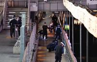 Police officers investigate the area around the Dotonbori River in Osaka's Chuo Ward on Aug. 2, 2021. (Mainichi/Ryoichi Mochizuki)
