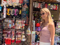 Ines Sainz, a sports anchor for Mexican broadcaster TV Azteca, is seen reporting in the Nakamise Shopping Street before Sensoji Temple in Tokyo's Taito Ward on July 21, 2021. (Mainichi/Sumire Kunieda)