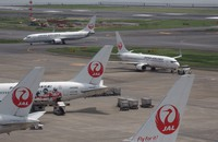 This May 10, 2019 file photo shows Japan Airlines Co. planes parked at Tokyo's Haneda airport. (Mainichi/Kenji Yoneda)