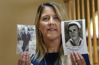 eri Mann Whyatt displays photos of her uncle, William Edward Mann, who died on the USS Arizona during the bombing of Pearl Harbor, at her home on July 14, 2021, in Newcastle, Wash.(AP Photo/Elaine Thompson)