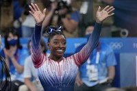 Simone Biles, of the United States, waves after performing on the balance beam during the artistic gymnastics women's apparatus final at the 2020 Summer Olympics, on Aug. 3, 2021, in Tokyo. (AP Photo/Ashley Landis)