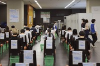 Visitors wait inside the recovery area after receiving the Pfizer COVID-19 vaccine at the Tokyo Vaccination Center at Aoyama Gakuin University in Tokyo on Aug. 2, 2021. (Stanislav Kogiku/Pool Photo via AP)