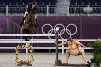 Britain's Harry Charles, riding Romeo 88, competes during the equestrian jumping individual qualifying at Equestrian Park in Tokyo at the Summer Olympics, on Aug. 3, 2021, in Tokyo, Japan. (AP Photo/Carolyn Kaster)