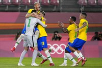 Brazil's players celebrate after defeating Mexico in a penalty shootout in a men's soccer semifinal match at the Summer Olympics, on Aug. 3, 2021, in Kashima, Japan. (AP Photo/Fernando Vergara)