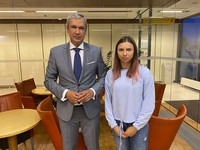 In this image taken on Aug. 4, 2021 and provided by the National Anti-crisis Management, Belarusian Olympic sprinter Krystsina Tsimanouskaya, right, who seeks foreign refuge from Minsk authorities, poses for a photo with top Belarusian dissident in Poland, Pavel Latushko, left, shortly after her arrival at the Frederic Chopin Airport in Warsaw, Poland. (National Anti-crisis Management via AP)
