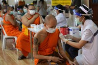 Health workers administer doses of the AstraZeneca COVID-19 vaccine to Buddhist monks at the Wat Srisudaram in Bangkok, Thailand, on July 30, 2021. (AP Photo/Sakchai Lalit)