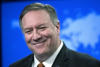 In this Nov. 26, 2019 file photo, then U.S. Secretary of State Mike Pompeo smiles as he speaks with reporters at the State Department in Washington. (AP Photo/Alex Brandon)
