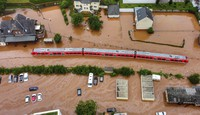 In this July 15, 2021 file photo, a regional train is seen in the flood waters at the local station in Kordel, Germany, after it was flooded by the high waters of the Kyll river. (Sebastian Schmitt/dpa via AP)