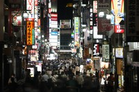 In this July 16, 2021 photo, people crowd the street in the Kabukicho area, Tokyo's entertainment district. (AP Photo/Jae C. Hong)