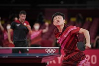Japan's Tomokazu Harimoto reacts after winning a match of the table tennis men's team semifinal against Germany's Patrick Franziskaat the 2020 Summer Olympics, on Aug. 4, 2021, in Tokyo. (AP Photo/Kin Cheung)