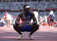 Cravon Gillespie, of United States reacts after finishing a semifinal of the men's 4 x 100-meter relay at the 2020 Summer Olympics, on Aug. 5, 2021, in Tokyo. (AP Photo/Francisco Seco)