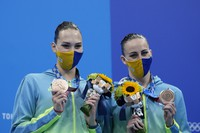 Marta Fiedina and Anastasiya Savchuk of Ukraine shows their medals during the medal ceremony of the duet free routine final at the 2020 Summer Olympics, on Aug. 4, 2021, in Tokyo. (AP Photo/Alessandra Tarantino)