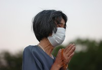 A woman offers a prayer in front of the Cenotaph for the A-bomb Victims at Hiroshima Peace Memorial Park on the morning of Aug. 6, 2021. (Mainichi/Kenji Ikai)